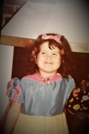 Me, smiling as a child, before I knew what depression was.