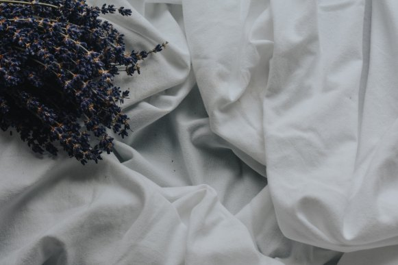 Lavender sprigs on sheets