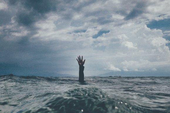 Drowning, desperate.